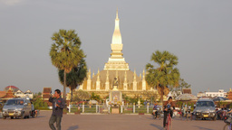 That Luang temple with kids riding bike,Vientiane,Laos Footage