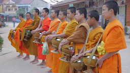 Monks pray for ower house after getting alms,Vang Vieng,Laos Footage