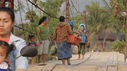 Tourists walking over a wooden bridge,Vang Vieng,Laos Footage
