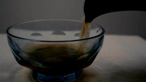 Close shot of pouring green tea in a tea container Footage