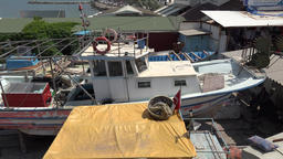 Turkey Aegean coast Aydin Province Kusadasi shabby fishing boat in boatyard Footage