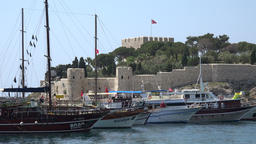 Turkey Aegean coast Aydin Province Kusadasi excursion boats and fortress ビデオ