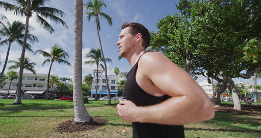 Man running jogging exercising on South Beach Miami Florida Art Deco District Footage