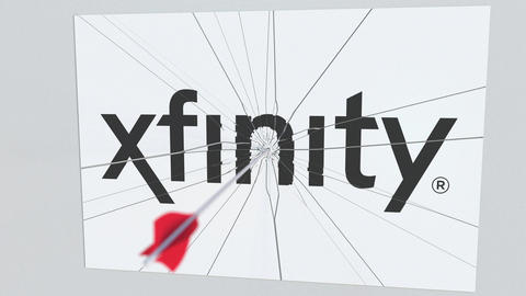 XFINITY company logo being cracked by archery arrow. Corporate problems Footage