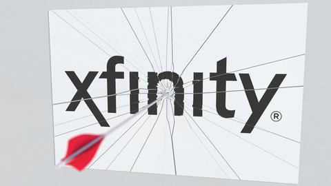 XFINITY company logo being cracked by archery arrow.... Stock Video Footage