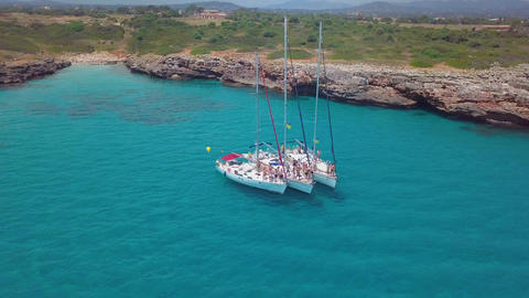 Yacht sailing on open sea at sunny day. Sailing boat in slow motion. Sailing Live Action