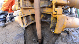 Deep drill rigs working in the town square Make a hole in the ground 04 Footage
