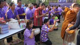 Monks collect alms on princess Sirindhorn birthday,Ubon Ratchathani,Thailand Footage