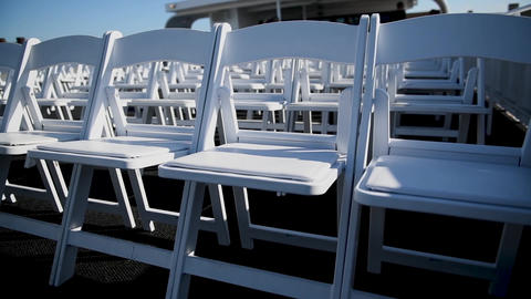 White chairs in a beautiful wedding ceremony. Wedding Footage