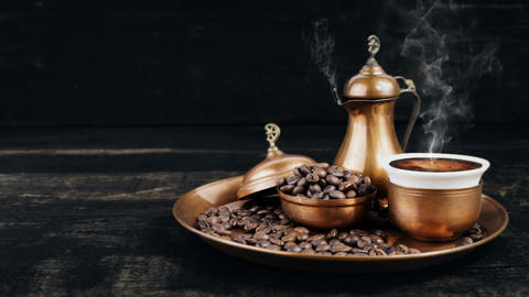 Turkish Coffee Smoking Hot In Vintage Traditional Copper Pot and Cup With Coffee Beans On The Animation