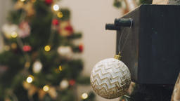Hanging Christmas decoration on tree with Christmas lights. Decorating on Footage