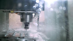 Shot of automatic cut sheet metal mechanism with liquid cooling on factory Footage