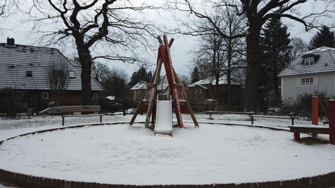 Snow covered slide on a children playground Photo