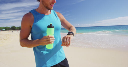 Sports smartwatch - Athlete runner drinking water or... Stock Video Footage