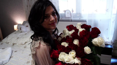 Beautiful girl sitting with a big bouquet of flowers, joy... Stock Video Footage