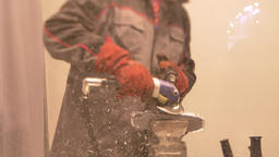 Portrait of man in boilersuit and gloves in enterprise cuts a metal part with 영상물