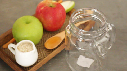 Apple with oats and honey smoothie in small jar Live Action