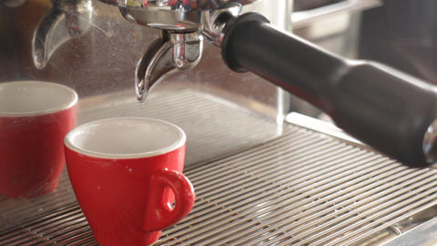 Hot espresso brewing from machine Live Action