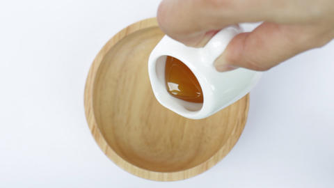 Pouring natural honey for healthy ingredient Live Action