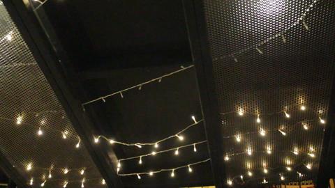 Decoration dim light hanging on black ceiling Footage