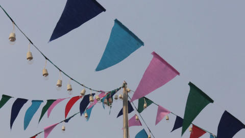 Colorful party flags on the windy sky Live Action