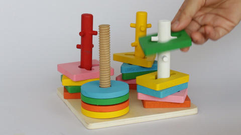 Demonstration of colorful puzzle wooden toy Live Action