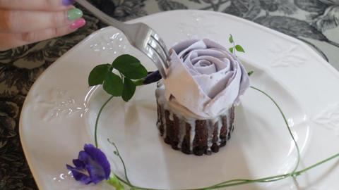 Woman enjoy having romantic rose cup cake Live Action