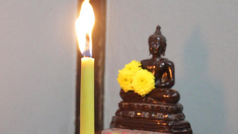 Buddha meditation with candle flame ビデオ