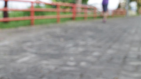 Woman running on a rural road ビデオ