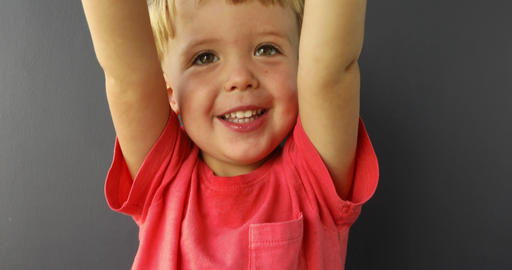 Child smiling asking for hold, wanting attention at home Stock Video Footage