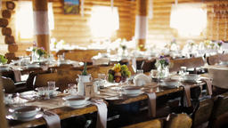 Wooden Banqueting Hall Decorated in Boho Style with Served Dining Tables Footage