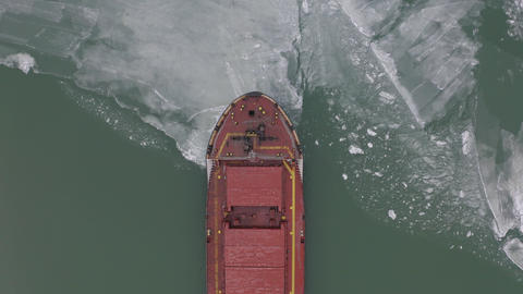 aerial view of the ship slowly moving through ice floes Footage
