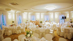 Festive Dining Tables Decorated for Wedding Banquet Celebration in Hall Interior Footage