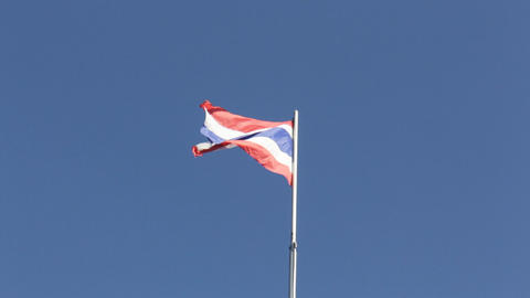 Thai flag of Thailand waving by windy blue sky Live Action