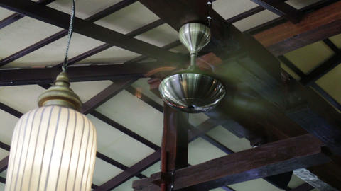 Vintage Electric Fan Hanging From Wooden Ceiling Footage