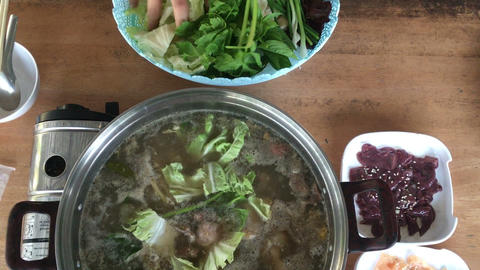 Boiling Sukiyaki Pot Adding Vegetables Footage