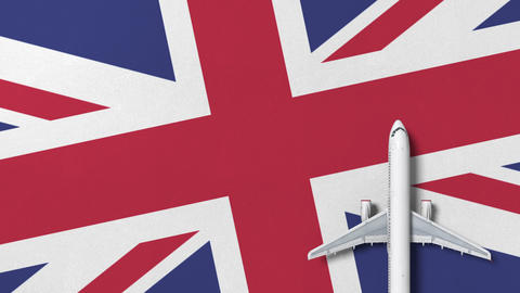 Commercial plane on the flag of Britain. Tourism related conceptual 3D animation Live Action