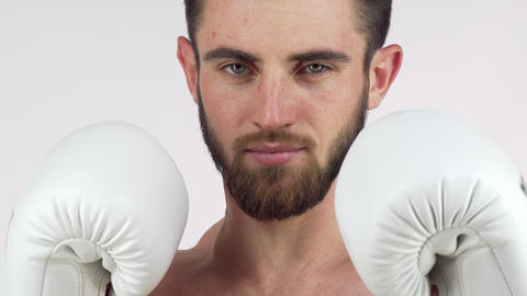 Bearded male boxer smiling to the camera, standing in fighting stance ビデオ