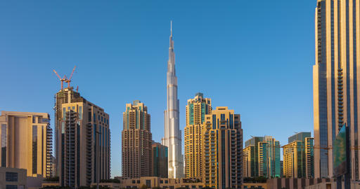 Panorama of skyscrapers and Burj Khalifa tower from day to night. Time Lapse Footage