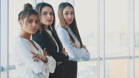 With pleasure, three business women cross their arms, looking at the camera Footage