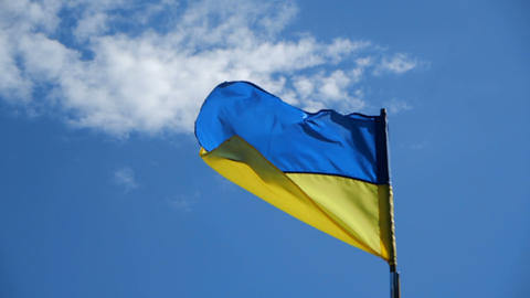 Flag of Ukraine in slow motion the action on the sunny day Footage