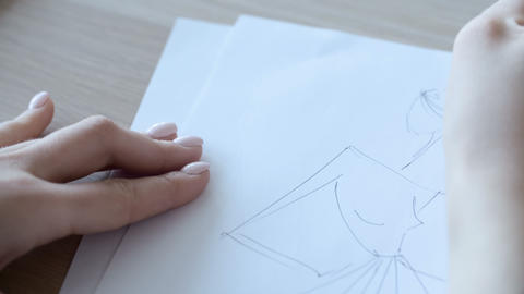 Hand of Female Drawing at Paper in Her Studio. Woman's Hand Draws a Pencil Footage