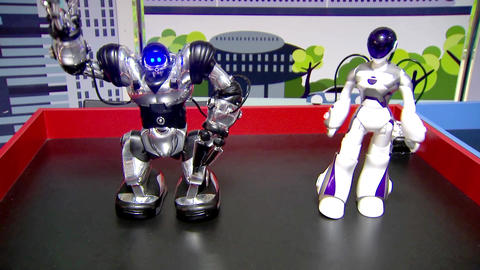 Toy robots for children dancing on the podium Footage