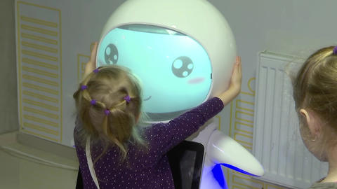 Girl hugging robot, children's love for toys, robotics... Stock Video Footage