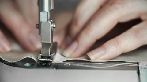 Macro Shot of Female Hands Working on Sewing Machine. Young Woman Concept Live Action