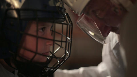 Dad and son hockey player dress up in the locker room 31 of 42 Live Action