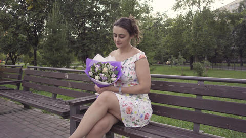 Young girl with a bouquet of flowers Footage