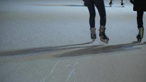 People skate on the ice rink, filled with ice Live Action