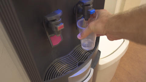 Pours water from a cooler Footage