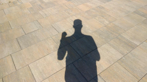 The shadow of a man showing an obscene gesture Live Action